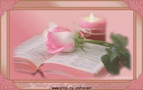 pink bible and candle